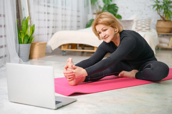 Woman-Practising-Pilates-in-front-of-Laptop
