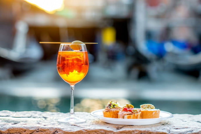Aperol Spritz and Italian finger food on the banks of Venice canal