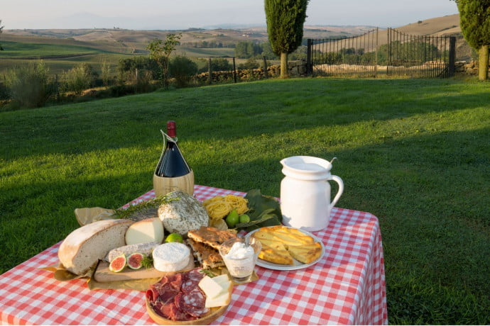 Tuscan bread cheese and meat on a table outside in the Tuscan hills