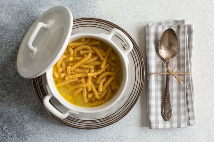 PASSATELLI IN BRODO in a plate on a table