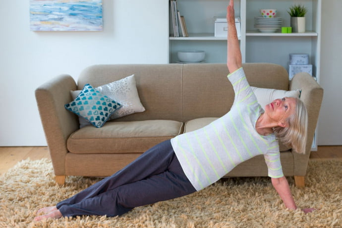 Lady practising Pilates in living room