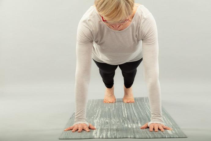 Lady doing pilates focused on bone health