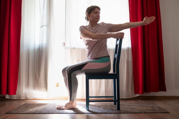 Lady doing Pilates in a chair